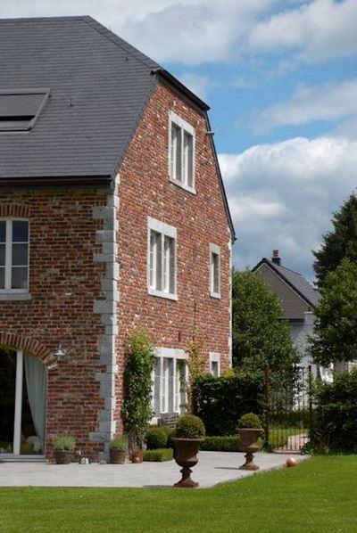 Entreprise de construction de maison à Spa: façade briques rouges