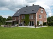 Entreprise de construction de maison à Spa: maison en briques rouges